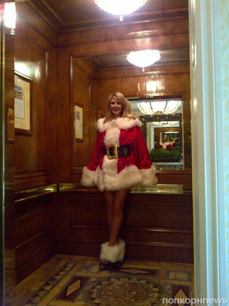 Хайди Клум в образе Санта-Клауса