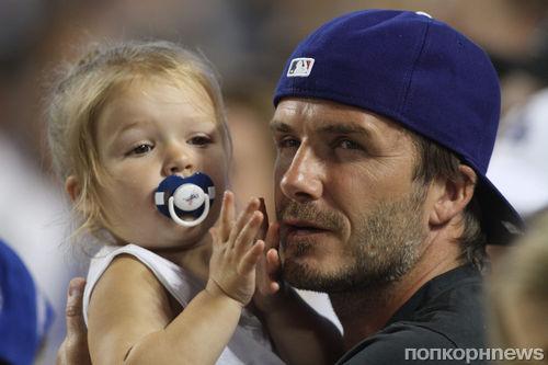 Дэвид Бекхэм с дочкой на игре Dodgers