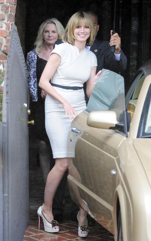 Хайди Клум с новой прической покидает фотосессию