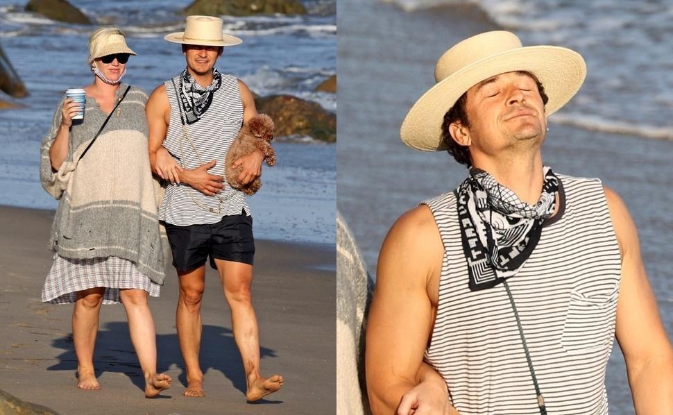 Фото: Орландо Блум и беременная Кэти Перри отдохнули на пляже с собаками